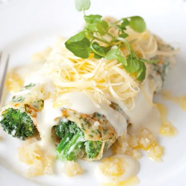 Herb pancakes with gruyère sauce