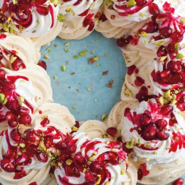 Pavolva wreath with pomegranate, cranberry and pistachios