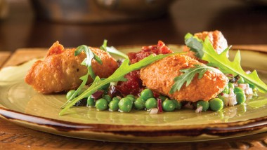 Goat's cheese beignets, tomato fondue and peas