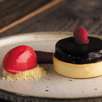 Dark chocolate and raspberry tart with raspberry jam, chocolate mousse and raspberry sorbet