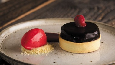 Dark chocolate and raspberry tart with raspberry jam, chocolate mousse and raspberry sorbet
