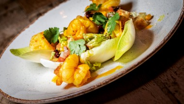 Cajun king prawns with chicory salad, croutons and lime dressing