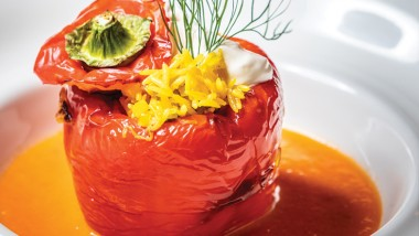 Baked red pepper with pilau rice, tomato sauce and sour cream