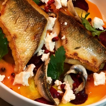 Wild sea bass, rainbow carrot salad, feta, anchovies, pink peppercorns & parsley