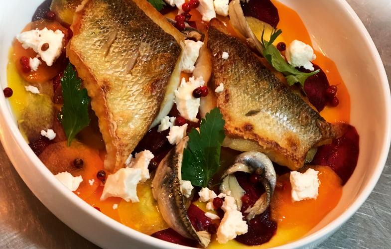 Wild sea bass, rainbow carrot salad, feta, anchovies, pink peppercorns & parsley