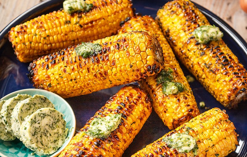 Barbecued corn cobs with shallot butter