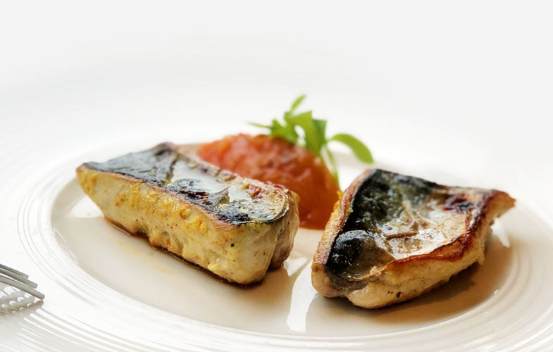 Moroccan-spiced mackerel with tomato and onion relish