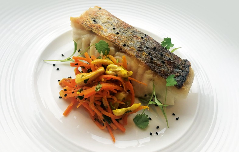 Roast hake and Bombay-style carrots with cashews and raisins