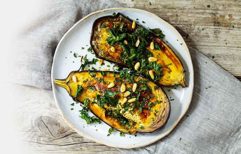 Roast aubergine with lemony kale and pine nuts