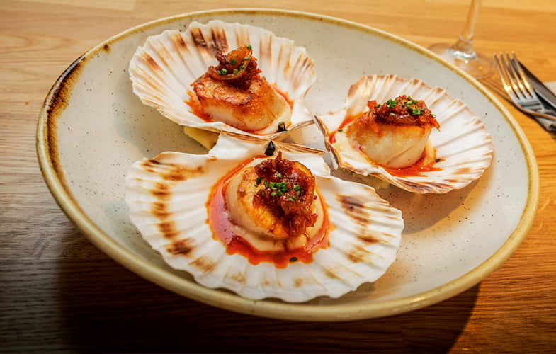 Roast scallops with chorizo jam