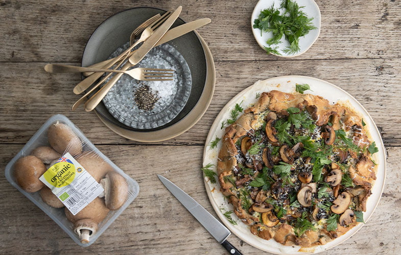 Buckwheat galette filled with mushrooms, ricotta, lemon zest and spring green herbs