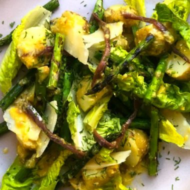 Jersey Royals and grilled asparagus with Caesar dressing, anchovies and Parmesan