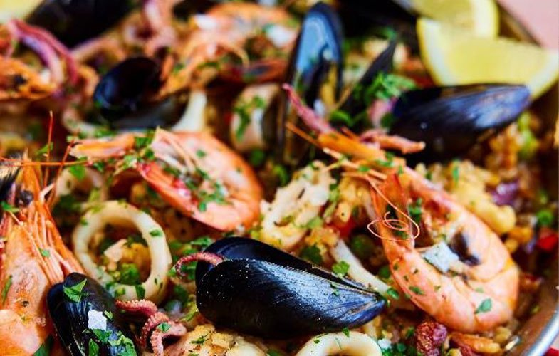 Paella with monkfish, prawns, squid and mussels