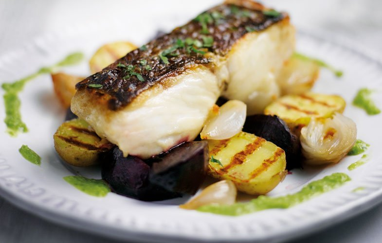 BBQ fillet of hake with roast veg, potatoes and  pea dressing